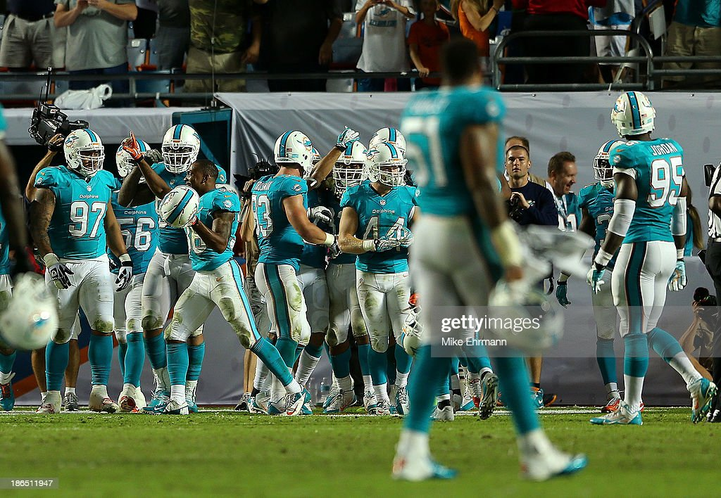 The Miami Dolphins celebrate winning a game against the Cincinnati Bengals at Sun Life Stadium on October 31, 2013 in Miami Gardens, Florida.