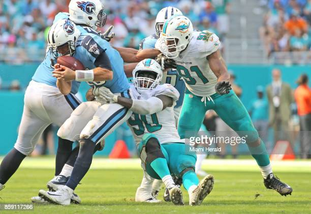 The Miami Dolphins' Charles Harris sacks Tennessee Titans quarterback Matt Cassel in the fourth quarter at Hard Rock Stadium in Miami Gardens Fla on...