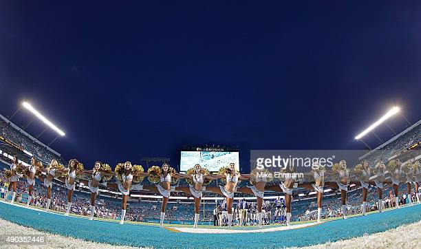 The Miami Dolphins cheerleaders perform during a game against the Buffalo Bills at Sun Life Stadium on September 27 2015 in Miami Gardens Florida