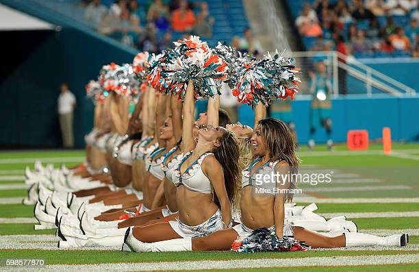 The Miami Dolphins cheerleaders perform during a preseason game against the Tennessee Titans at Hard Rock Stadium on September 1 2016 in Miami...