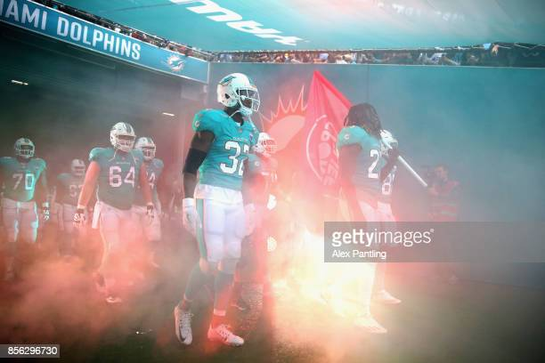 The Miami Dolphins make their way onto the field during the NFL International Series match between New Orleans Saints and Miami Dolphins at Wembley...