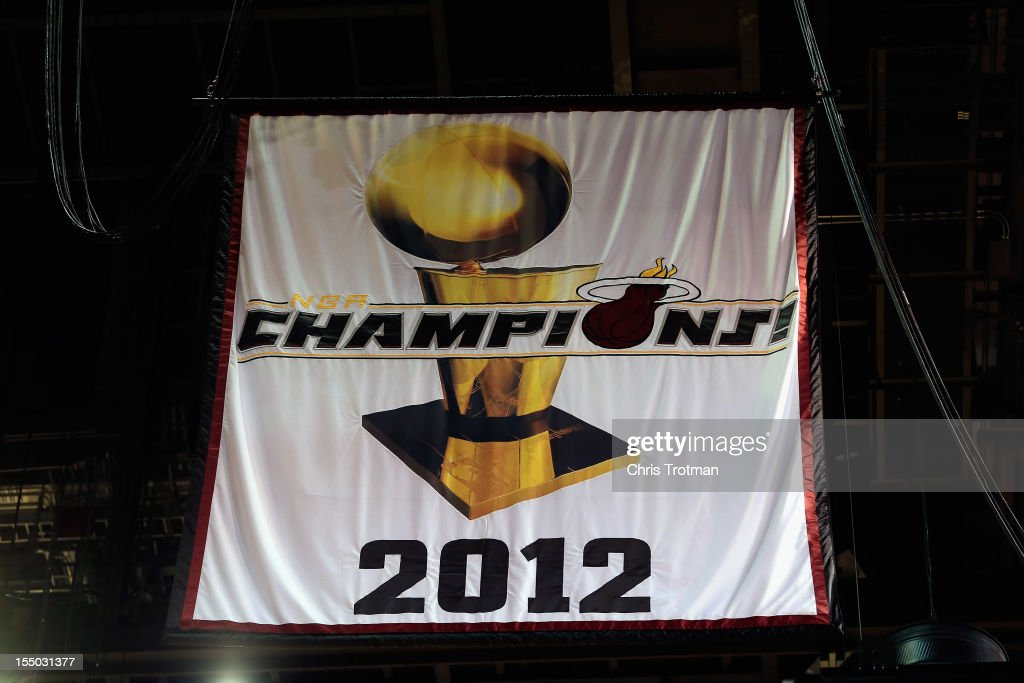 The Miami Heat 2012 NBA Championship banner is raised at the American Airlines Arena prior to the game against the Boston Celtics on October 30, 2012 in Miami, Florida.