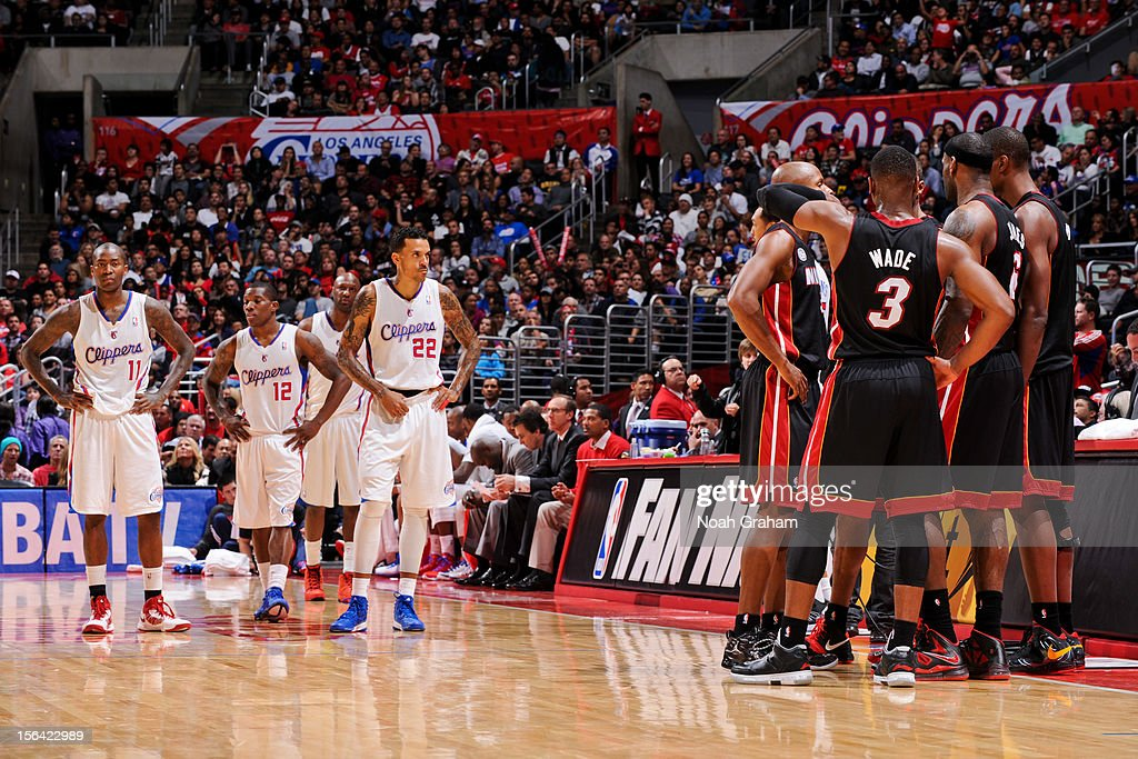 The Miami Heat and Los Angeles Clippers wait to resume action in the fourth quarter of their game at the Staples Center on November 14, 2012 in Los Angeles, California.