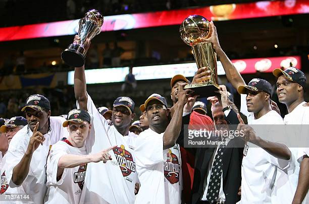 The Miami Heat celebrate as they receive the Larry O'Brien trophy after the Heat defeated the Dallas Mavericks in game six of the 2006 NBA Finals on...
