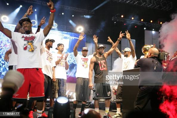 The Miami Heat celebrate during the rally for seasonticket holders at the American Airlines Arena after their NBA championship parade through...