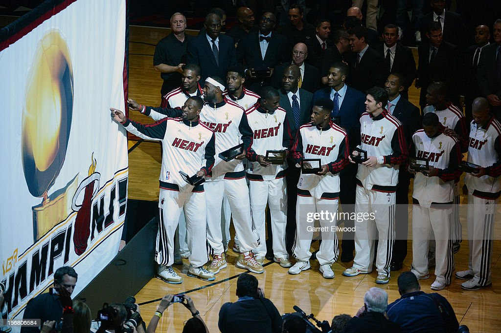 The Miami Heat celebrate their 2012 NBA Championship before the game against the Boston Celtics on October 30, 2012 at American Airlines Arena in Miami, Florida.