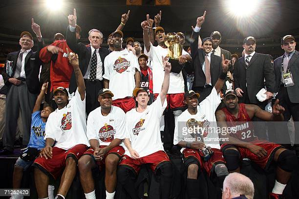 The Miami Heat celebrate with the Larry O'Brien Trophy after the beat the Dallas Mavericks 9592 in Game Six of the 2006 NBA Finals to win the NBA...