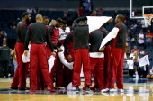 The Miami Heat huddle at center court as they take off their warm up jerseys before their game against the Charlotte Bobcats in Game Four of the...