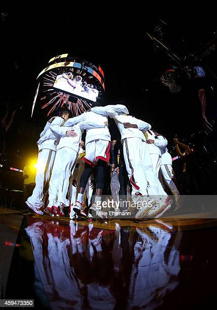 The Miami Heat huddle before a game against the Charlotte Hornets at American Airlines Arena on November 23 2014 in Miami Florida NOTE TO USER User...