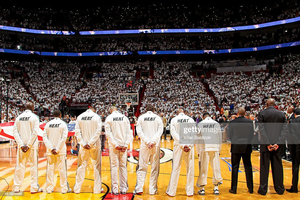 The Miami Heat listen to the National Anthem before playing against the Milwaukee Bucks in Game One of the Eastern Conference Quarterfinals during the 2013 NBA Playoffs on April 21, 2013 at American Airlines Arena in Miami, Florida.