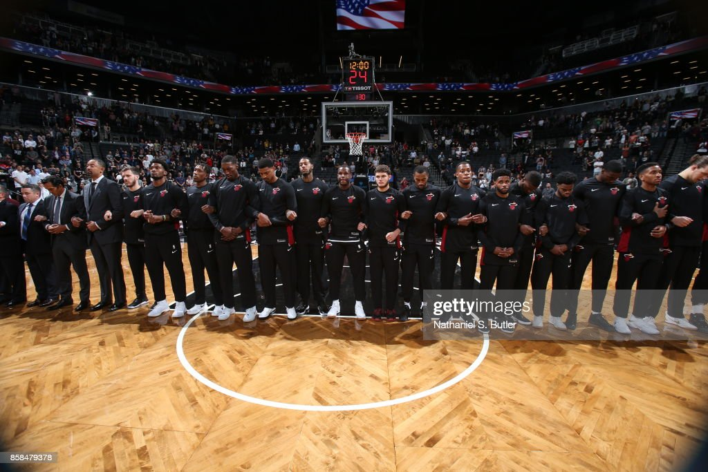 The Miami Heat stand for a moment of silence for the National Anthem before the game against the Brooklyn Nets during a preseason game on October 5, 2017 at Barclays Center in Brooklyn, New York.