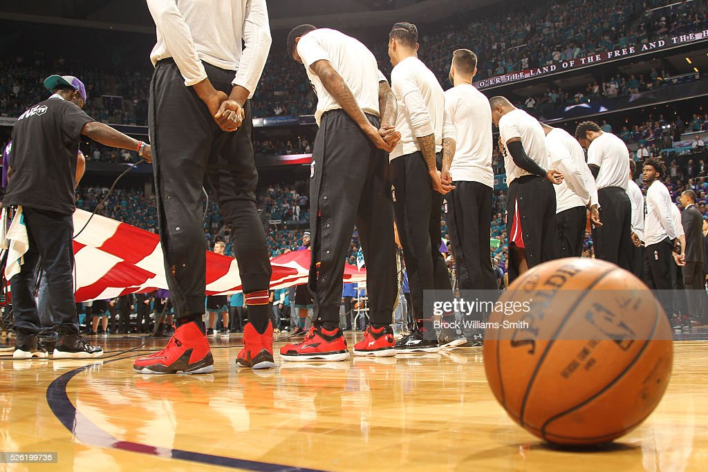 The Miami Heat stand for the National Anthem before the game against the Charlotte Hornets in Game Six of the Eastern Conference Quarterfinals during the 2016 NBA Playoffs on April 29, 2016 at Time Warner Cable Arena in Charlotte, North Carolina.