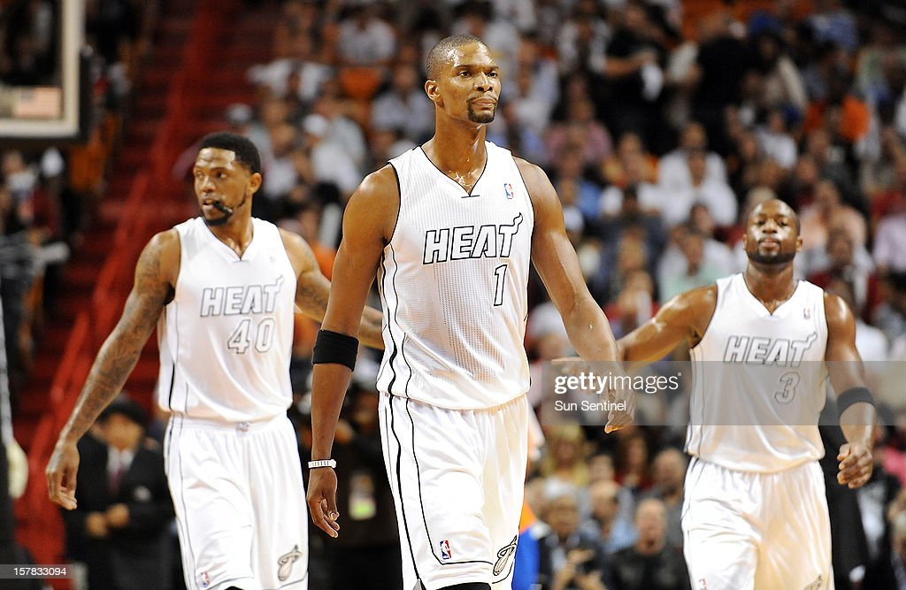 The Miami Heat's Chris Bosh (1) appears angry as he and teammates head to the bench for a timeout during the game against the New York Knicks at American Airlines Arena in Miami, Florida, Thursday, December 6, 2012.