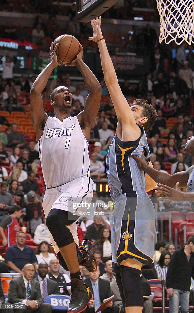 The Miami Heat's Chris Bosh goes to the basket against Marc Gasol of the Memphis Grizzlies during the third quarter at the AmericanAirlines Arena in Miami, Florida, on Friday, March 1, 2013. Miami won, 98-91.