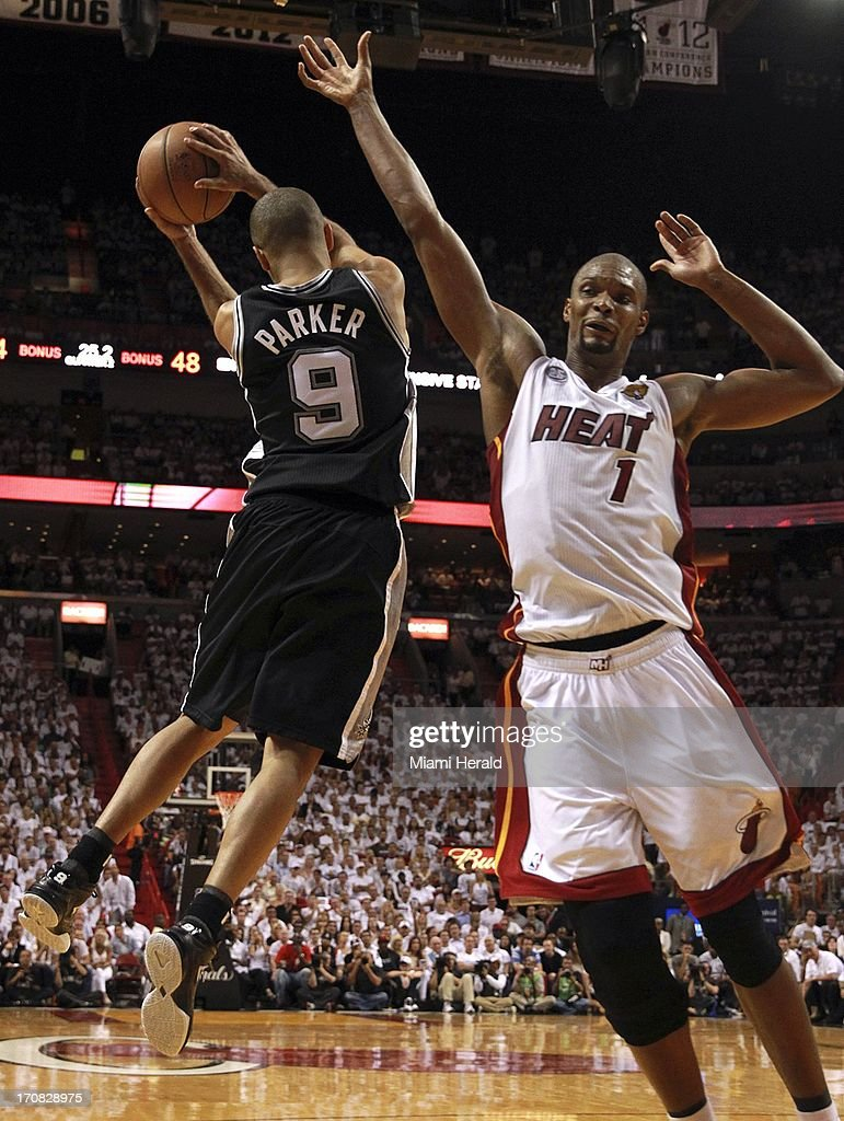 The Miami Heat's Chris Bosh loses a rebound tot he San Antonio Spurs' Tony Parker (9) in the second quarter in Game 6 of the NBA Finals on Tuesday, June 18, 2013, at the AmericanAirlines Arena in Miami, Florida.