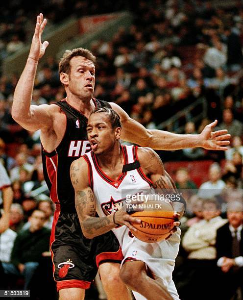 The Miami Heat's Dan Majerle watches as the Philadelphia 76ers Allen Iverson moves past him on his way to the basket in the first period of tonight's...
