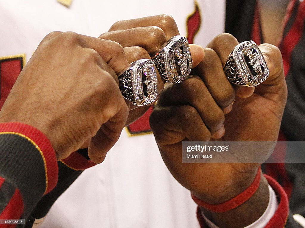 The Miami Heat's Dwyane Wade, Chris Bosh and LeBron James show their NBA Championship rings during a ceremony at the American Airlines Arena in Miami, Florida, before the season-opener against the Boston Celtics on Tuesday, October 30, 2012.