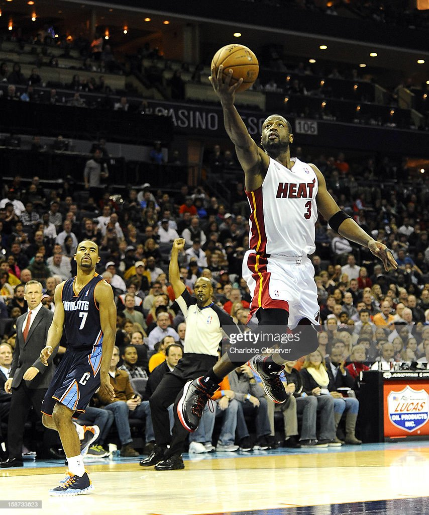 The Miami Heat's Dwyane Wade (3) drives, drawing a continuation foul against the Charlotte Bobcats, during the second half at Time Warner Cable Arena in Charlotte, North Carolina, on Wednesday, December 26, 2012. Miami topped Charlotte, 105-92.