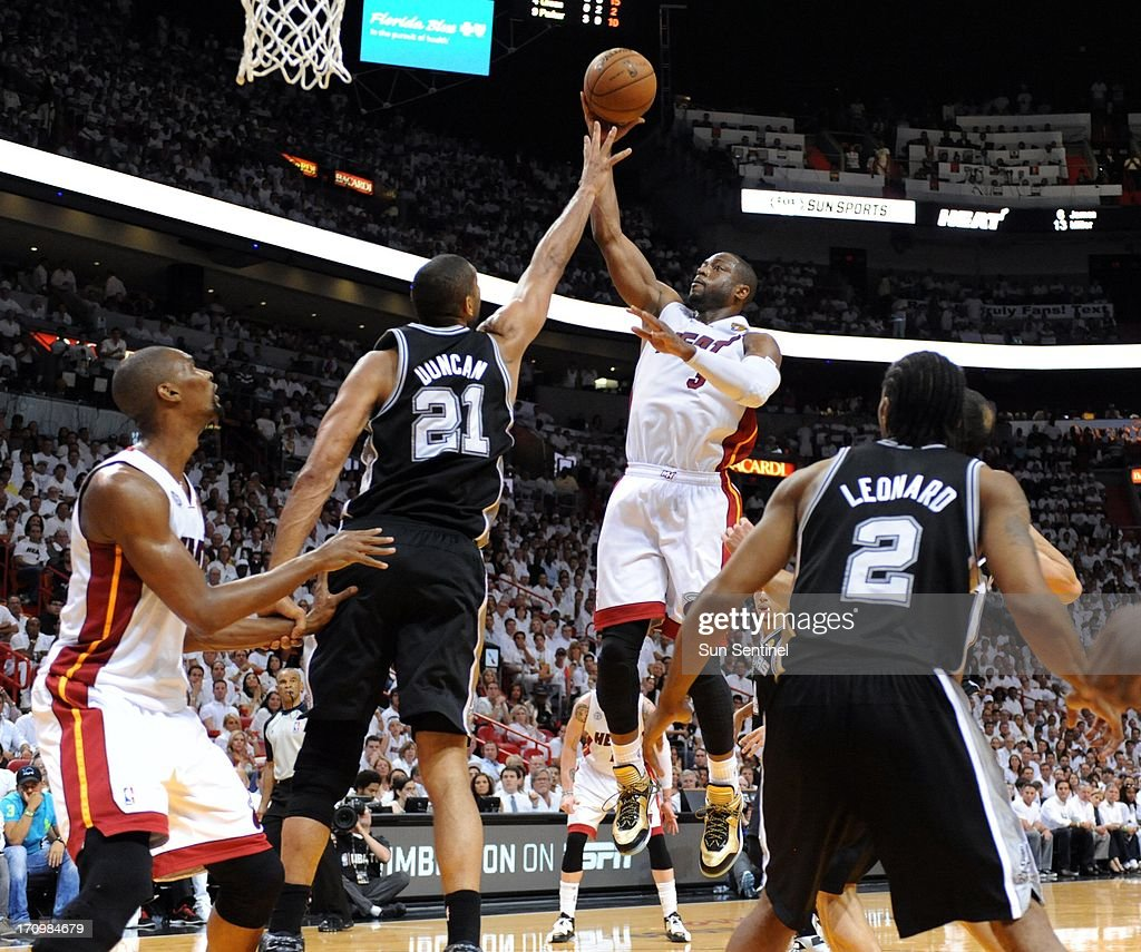 The Miami Heat's Dwyane Wade goes up for a shot against the San Antonio Spurs in the third quarter in Game 7 of the NBA Finals at the AmericanAirlines Arena in Miami, Florida, on Thursday, June 20, 2013.