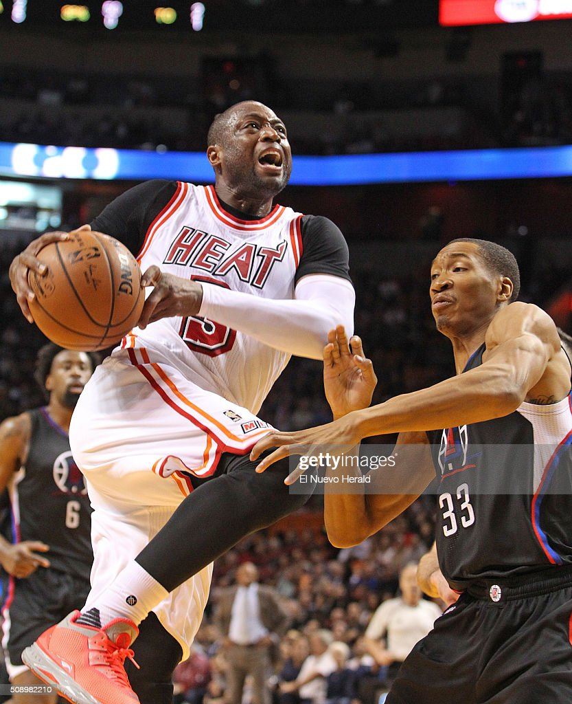 The Miami Heat's Dwyane Wade, left, drives against the Los Angeles Clippers' Wesley Johnson in the second quarter at the AmericanAirlines Arena in Miami on Sunday, Feb. 7, 2016. The Clippers won, 100-93.