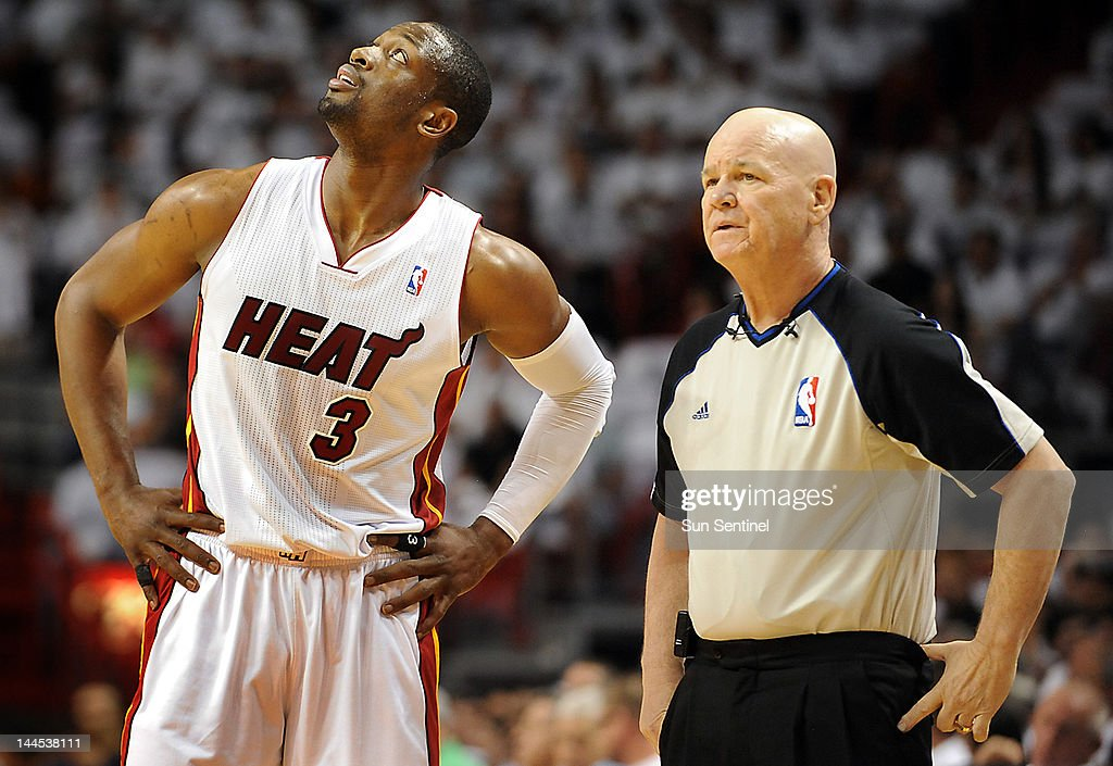 The Miami Heat's Dwyane Wade (3) looks at a replay on the scoreboard that he thinks official Joey Crawford, right, should have ruled differently against the Indiana Pacers during Game 2 of the Eastern Conference Semifinals at American Airlines Arena in Miami, Florida, on Tuesday, May 15, 2012.