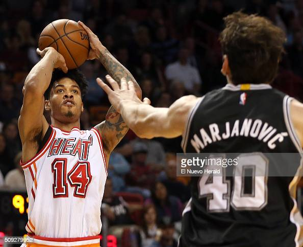 The Miami Heat's Gerald Green shoots a 3pointer over the San Antonio Spurs' Boban Marjanovic in the fourth quarter at AmericanAirlines Arena in Miami...