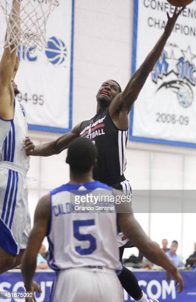 The Miami Heat's James Ennis scores over the Detroit Pistons' Kentavious CaldwellPope during NBA Summer League action at the Amway Center in Orlando...