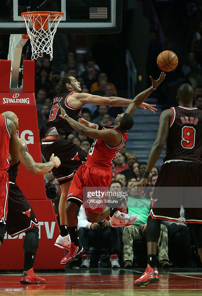 The Miami Heat's Joakim Noah (13) tries to block the shot of the Miami Heat's Mario Chalmers in the first quarter at the United Center in Chicago, Illinois, on Thursday, February 21, 2013. The Heat stifled the Bulls, 86-67.