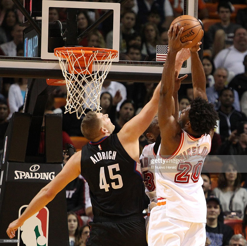 The Miami Heat's Justise Winslow, right, battles the Los Angeles Clippers' Cole Aldrich for a rebound in the fourth quarter at the AmericanAirlines Arena in Miami on Sunday, Feb. 7, 2016. The Clippers won, 100-93.