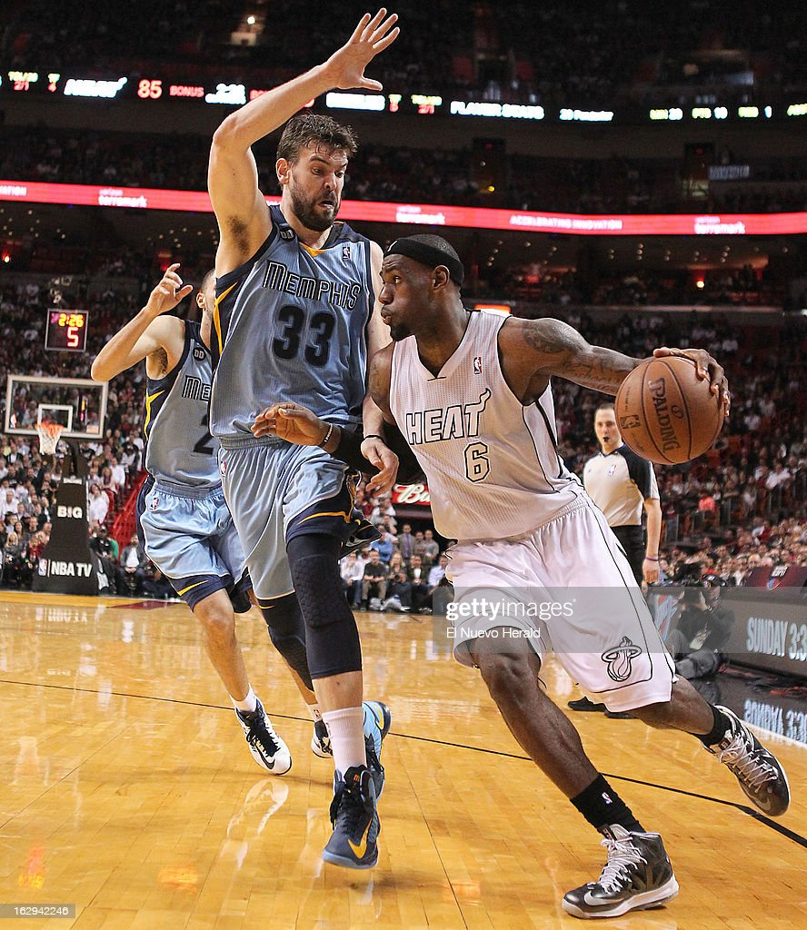The Miami Heat's LeBron James drives against the Memphis Grizzlies' Marc Gasol during the fourth quarter at the AmericanAirlines Arena in Miami, Florida, on Friday, March 1, 2013. Miami won, 98-91.
