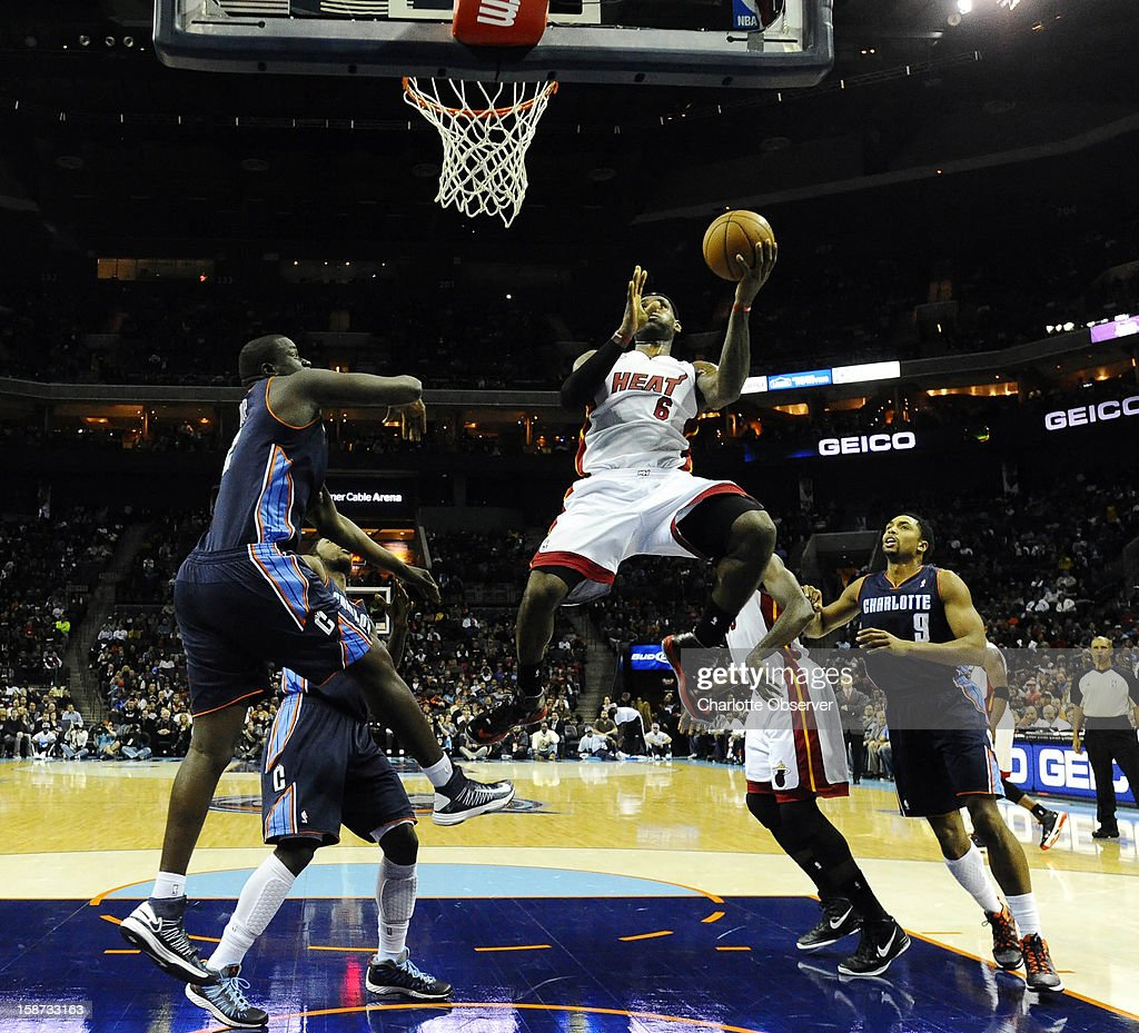 The Miami Heat's LeBron James (6) drives in between the Charlotte Bobcats' DeSagana Diop (2) and Gerald Henderson (9) during the first half at Time Warner Cable Arena in Charlotte, North Carolina, on Wednesday, December 26, 2012.
