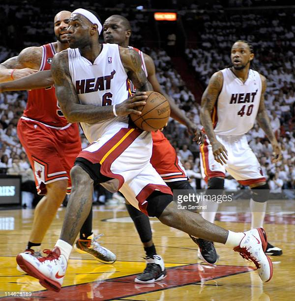 The Miami Heat's LeBron James drives to the basket against the Chicago Bulls in the third quarter in Game 4 of the NBA's Eastern Conference finals at...