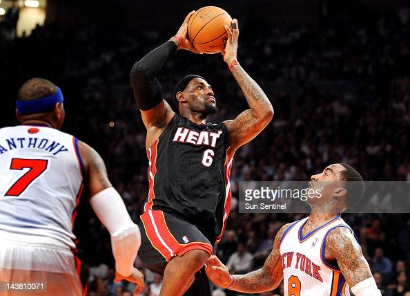 The Miami Heat's LeBron James drives to the basket between the New York Knicks' Carmelo Anthony and JR Smith during Game 3 of the Eastern Conference...