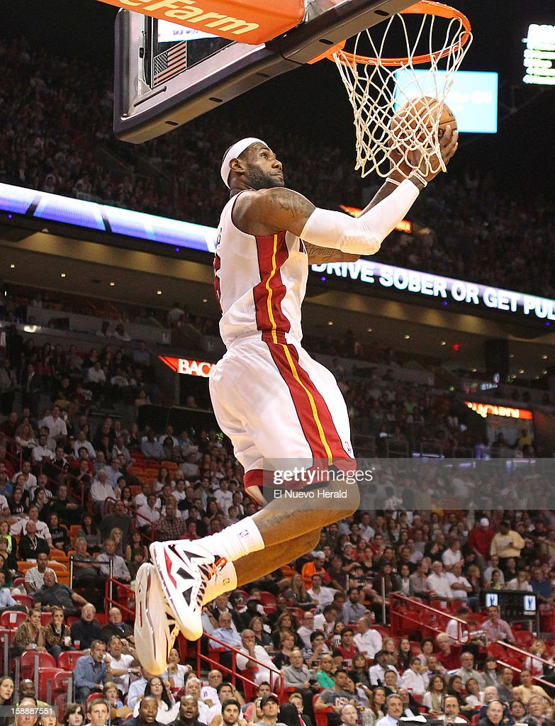 The Miami Heat's LeBron James dunks during the first quarter against the Dallas Mavericks at the AmericanAirlines Arena in Miami, Florida, on Wednesday, January 2, 2013.