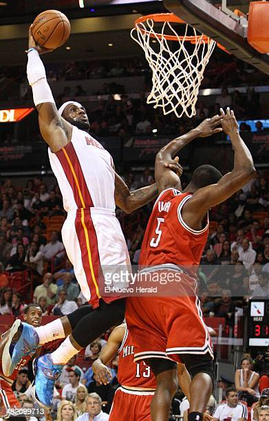 The Miami Heat's LeBron James goes for a tomahawk dunk in the first quarter against the Milwaukee Bucks at the American Airlines Arena in Miami on...