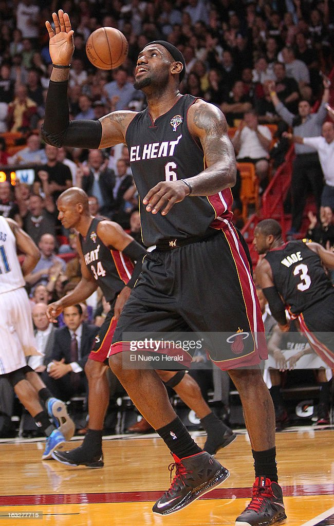 The Miami Heat's LeBron James reacts after a dunk during the second quarter against the Orlando Magic at the AmericanAirlines Arena in Miami, Florida, on Wednesday, March 6, 2013.