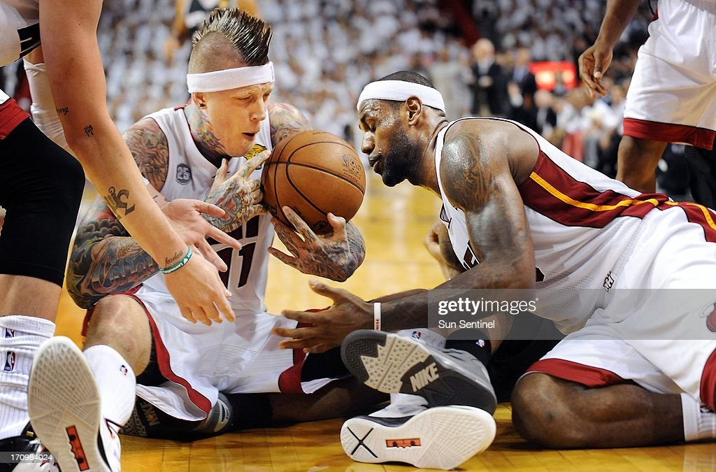 The Miami Heat's LeBron James, right, and Chris Andersen scramble to get a loose ball away from the San Antonio Spurs' Kawhi Leonard in the second quarter of Game 7 of the NBA Finals at the AmericanAirlines Arena in Miami, Florida, on Thursday, June 20, 2013.
