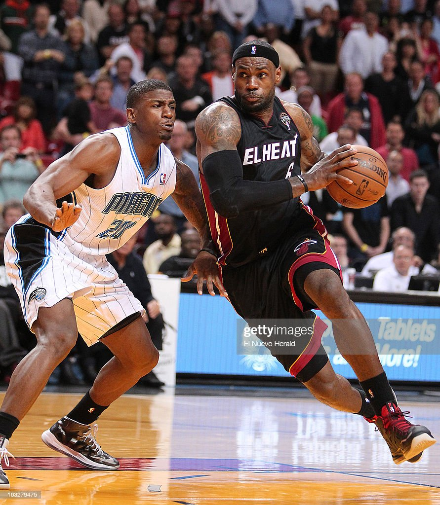 The Miami Heat's LeBron James, right, drives against the Orlando Magic's DeQuan Jones in the during the fourth quarter at the AmericanAirlines Arena in Miami, Florida, on Wednesday, March 6, 2013. Miami edged Orlando, 97-96.