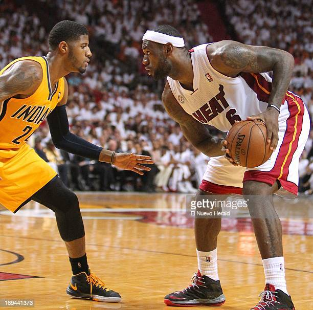 The Miami Heat's LeBron James right sizes up the Indiana Pacers' Paul George during the second quarter in Game 2 of the Eastern Conference finals at...