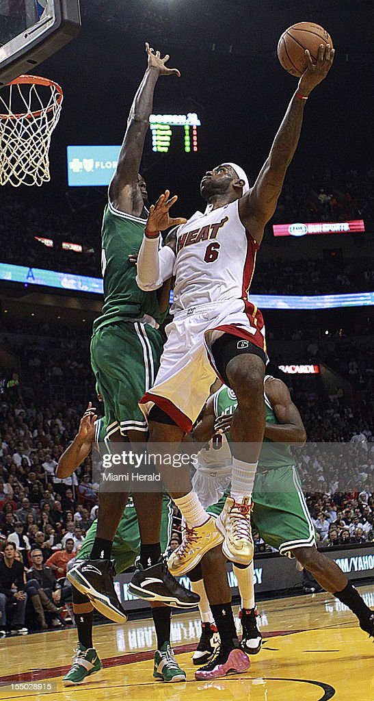 The Miami Heat's LeBron James shoots over the Boston Celtics' Kevin Garnett in the first quarter at the American Airlines Arena in Miami, Florida, on Tuesday, October 30, 2012.
