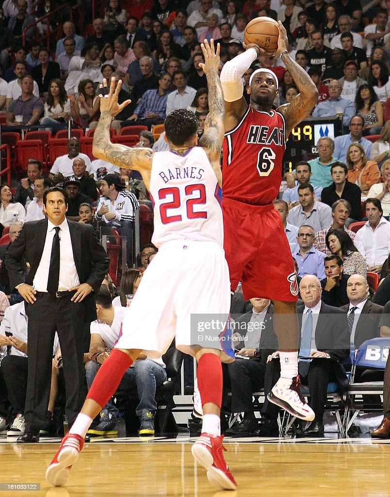 The Miami Heat's LeBron James shoots over the Los Angeles Clippers' Matt Barnes (22) during the first quarter at the AmericanAirlines Arena in Miami, Florida, on Friday, February 8, 2013.