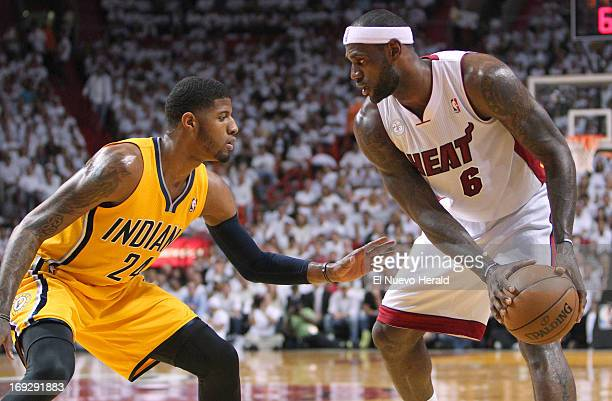 The Miami Heat's LeBron James sizes up the Indiana Pacers' Paul George in the first quarter in Game 1 of the Eastern Conference finals at the...