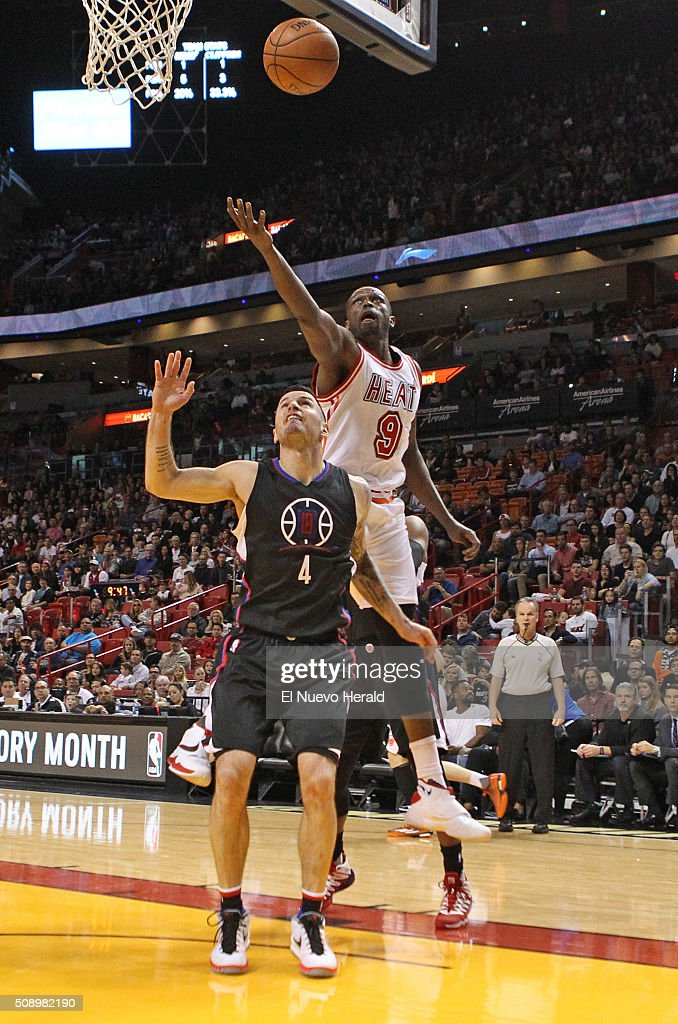 The Miami Heat's Loul Deng, top, reaches for a rebound over the Los Angeles Clippers' J.J. Redick in the first quarter at the AmericanAirlines Arena in Miami on Sunday, Feb. 7, 2016. The Clippers won, 100-93.
