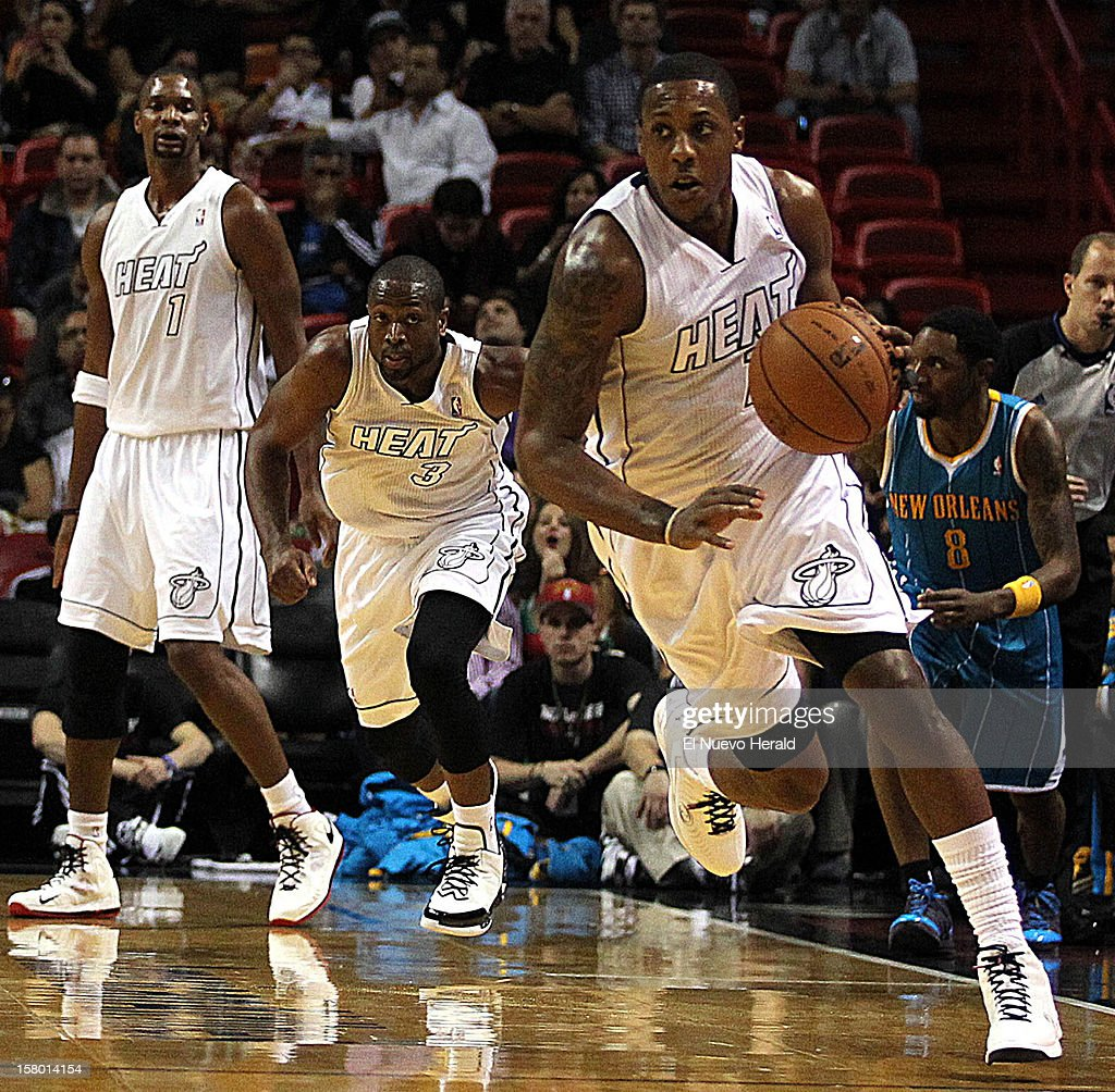 The Miami Heat's Mario Chalmers dribbles upcourt after stealing the ball from the New Orleans Hornets' Roger Mason Jr. during the first quarter at the AmericanAirlines Arena in Miami, Florida, on Saturday, December 8, 2012. The Heat won, 106-90.