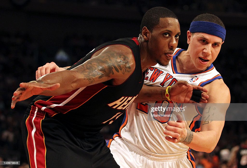 The Miami Heat's Mario Chalmers, left, pushes the New York Knicks' Mike Bibby in the fourth quarter of Game 4 of the NBA Eastern Conference Quarterfinals at Madison Square Garden in New York City, Sunday, May 6, 2012. The Knicks defeated the Heat, 89-87.