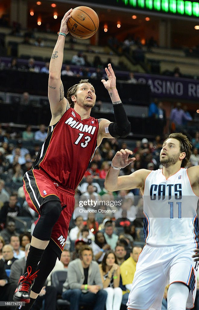 The Miami Heat's Mike Miller (13) drives to the basket as the Charlotte Bobcats' Josh McRoberts (11) looks during second-half action on Friday, April 5, 2013 at Time Warner Cable Arena in Charlotte, North Carolina. Miami won, 89-79.