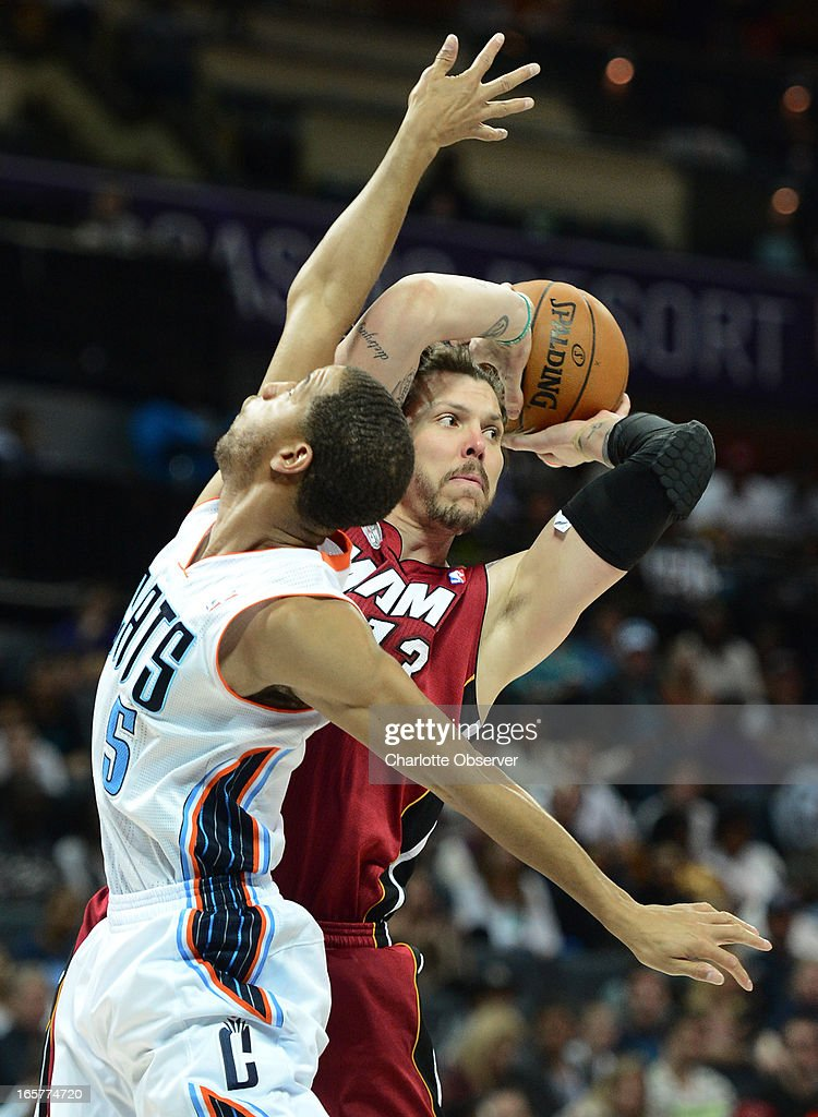 The Miami Heat's Mike Miller, right, looks to pass as the Charlotte Bobcats' Jannero Pargo applies defensive pressure during second-half action on Friday, April 5, 2013 at Time Warner Cable Arena in Charlotte, North Carolina. Miami won, 89-79.