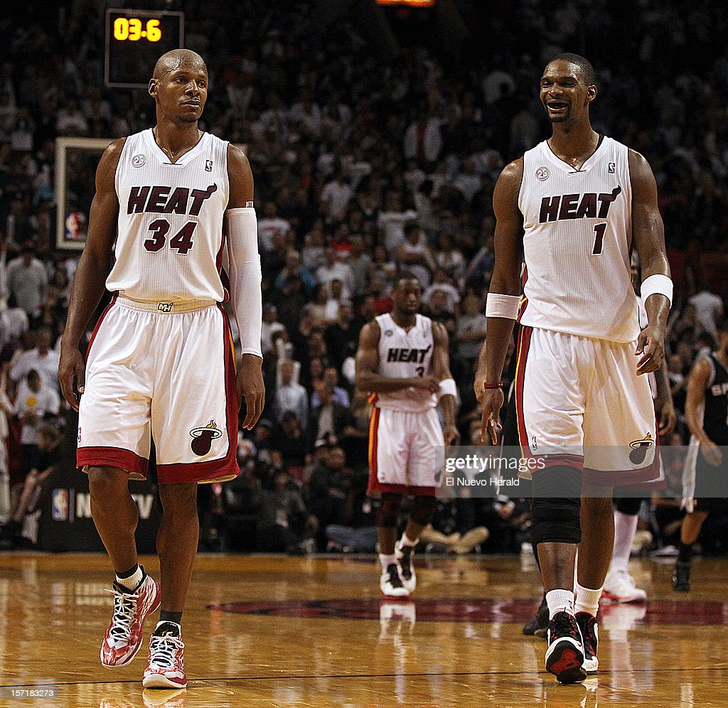 The Miami Heat's Ray Allen (34) and Chris Bosh walk back the the bench during a time out in the fourth quarter against the San Antonio Spurs at AmericanAirlines Arena in Miami, Florida, on Thursday, November 29, 2012. The Heat edged the Spurs, 105-100.