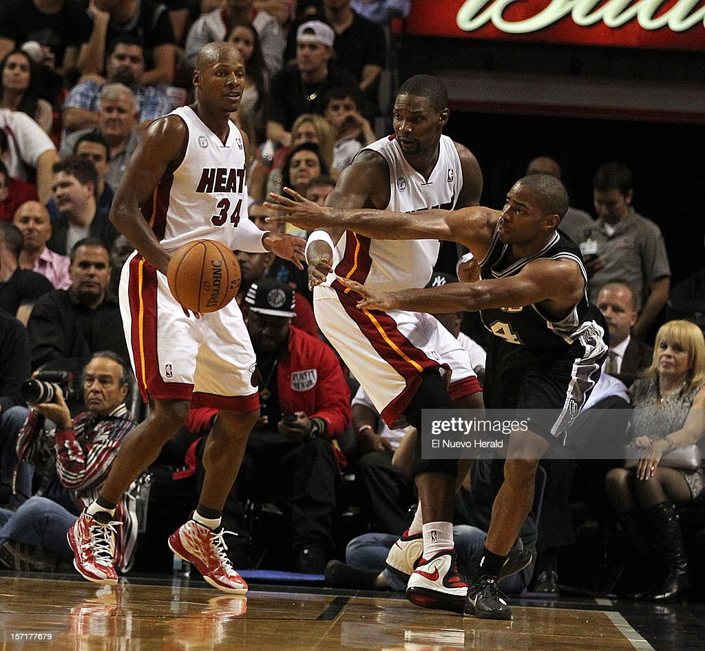 The Miami Heat's Ray Allen, left, and Chris Bosh defend against the San Antonio Spurs' Gary Neal, right, during the second quarter at AmericanAirlines Arena in Miami, Florida, on Thursday, November 29, 2012.