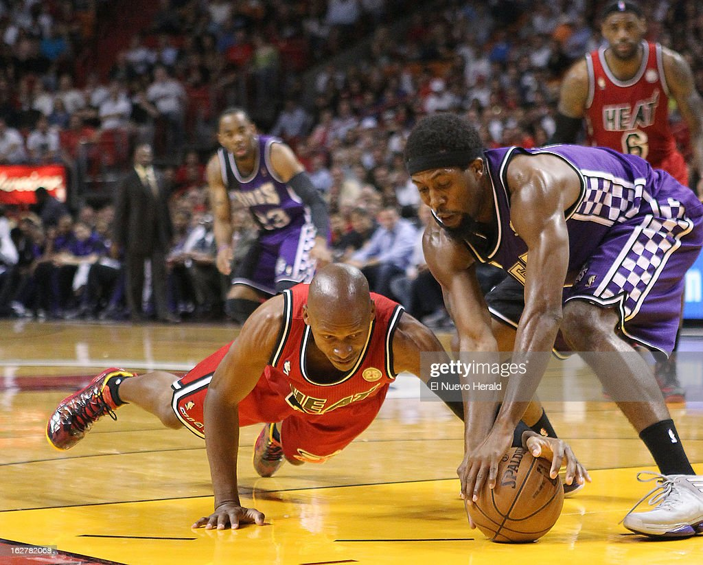 The Miami Heat's Ray Allen, left, dives for a lose ball against the Sacramento Kings' John Salmons during the first quarter at the American Airlines Arena in Miami, Florida, Tuesday, February 26, 2013. The Heat defeated the Kings in double overtime, 141-129.